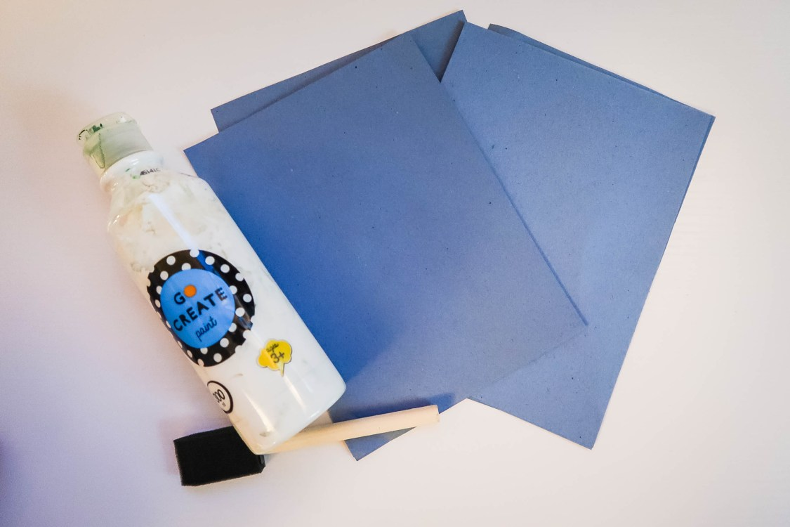What you need for your snowman cards - step one: blue craft paper | white poster paint | paint brust | little feet