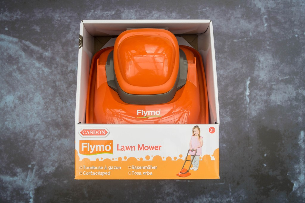 The Casdon Flymo Lawn Mower in it's box