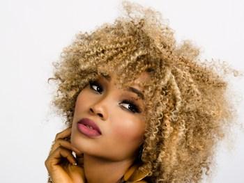 woman-face-curly-hair-