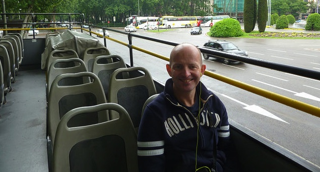 Hop-on Hop-Off Bus Tour Madrid. Struggling to keep the earphones in...