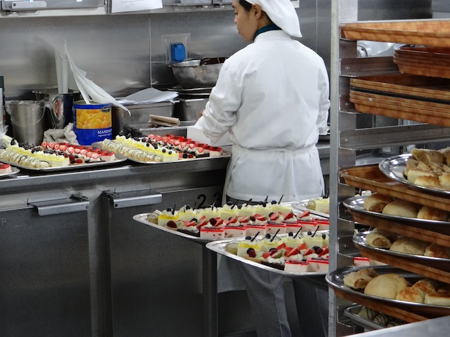 Afternoon tea cakes being prepared on Holland America Nieuw Amsterdam