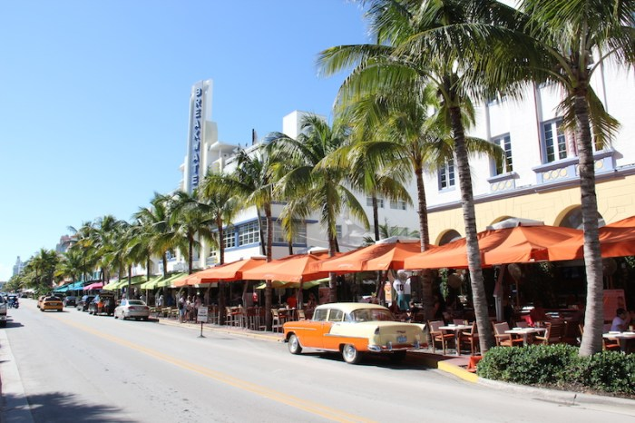 Cafes line the street of Miami South Beach Art Deco Buildings