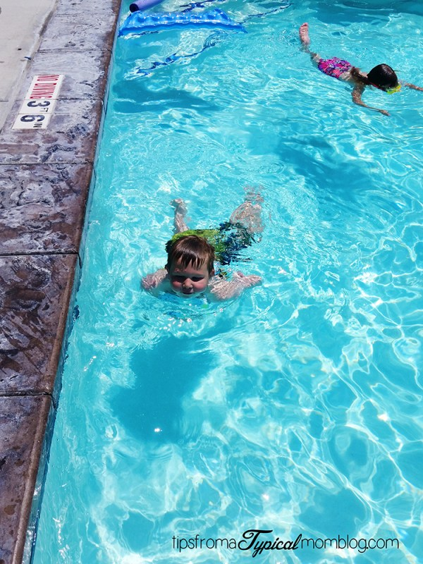 How do I teach my child to swim