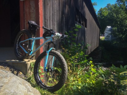 Perfect setting for a perfect bike - Jon's Wiseman Frameworks custom fatbike hanging from a covered bridge at checkpoint number one: a much needed break after 20+ miles of climbing early in the day.