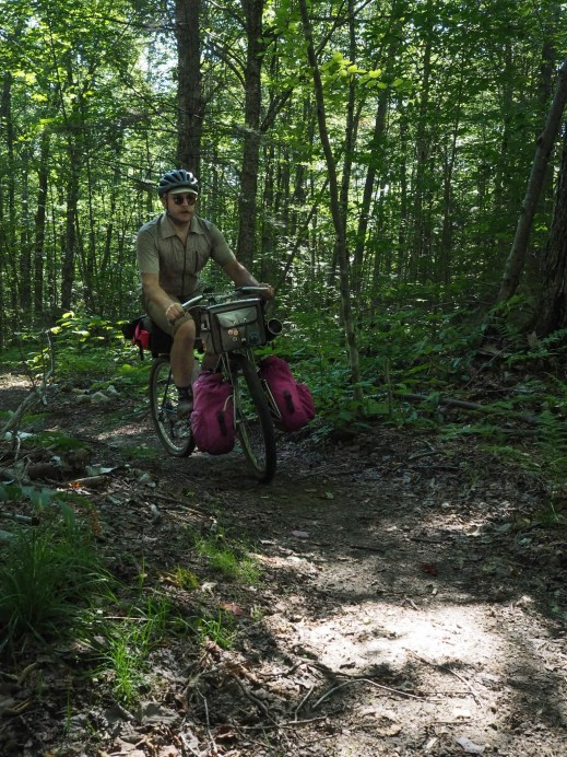 Ben climbing a short section of singletrack in Groton State Forest