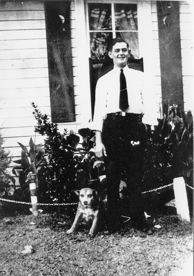 Uncle Allen with his dog in front of the Williams home on Hwy 70