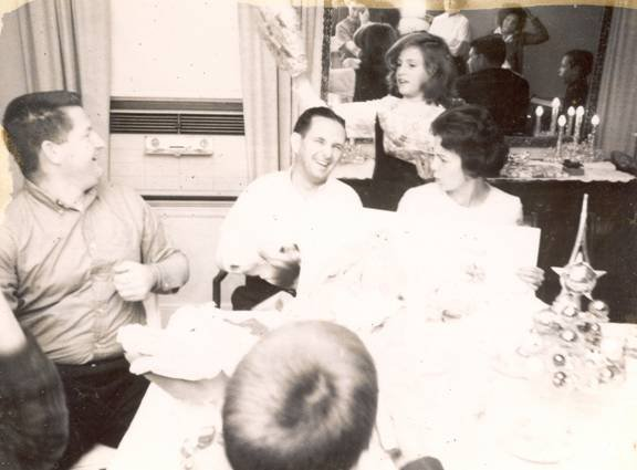 Mom and Dad at a family dinner. Dad was being bad judging by the look on Mom's face. Glenn thought it was great!