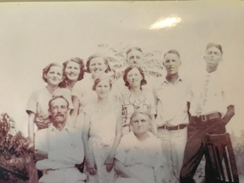 Faulk Family: Front: Mr Jim, Vera, Minnie Back: Mabel, Audrey, Edna Earl, Lexie, Floyd (mustache), Morris, Roy