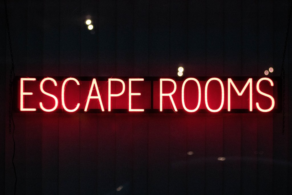 A neon sign for an escape room