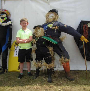 person and scarecrow