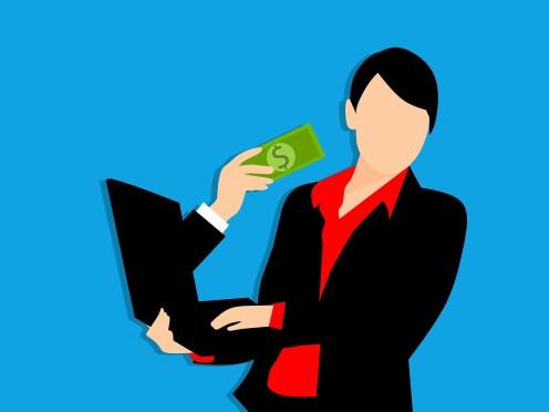 En la imagen, un dibujo de una chica o chico con un ordenador portátil al que le sale un brazo de su pantalla con un billete en la mano