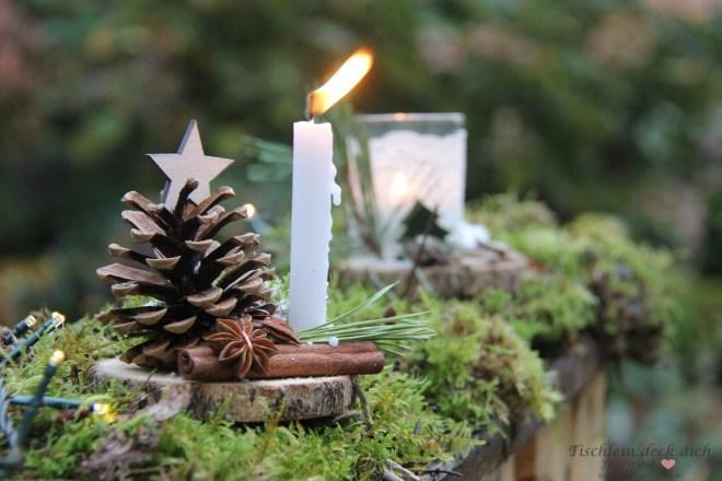 Winterdeko-im-Garten-mit-Kerzenschein