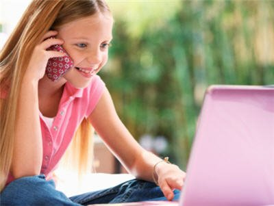 girl-on-laptop-and-cell-phone