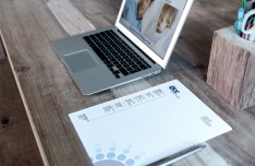 Mac Book & Letterhead On Desk Mockup