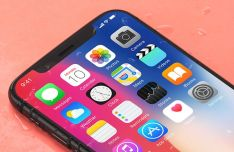 Realistic iPhone X On The Desk PSD Mockup