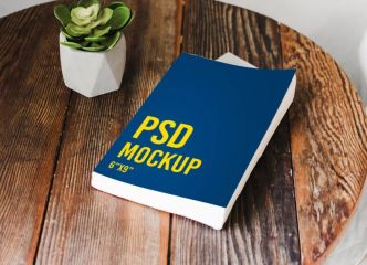 Book Beside Table PSD Mockup
