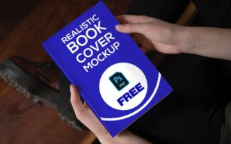 Realistic Book Cover In Hand Mockup PSD