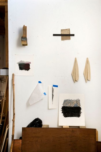 Studio wall with art works.