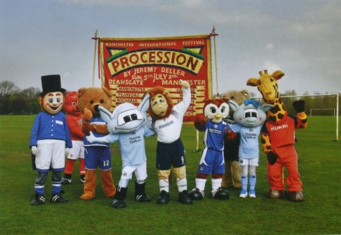 Manchester football mascots holding banner from Procession, 2009
