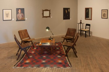 "(Left to Right) Sidney Apt - ""Self Portrait"" Sidney Apt - ""Self Portrait"" Artist Unknown - ""Tramp Art Mirror"" Thomas Ockerse - ""The A-Z Book"" (on table) Billy Blaise Dufala - ""Hamburger Rock (on table) Naftal Nyoma - ""Emwanka"" (on table) Mr. Imagination - ""Relics"" Hy Snell - ""Soldier's Torso"" Thomas Nast - ""Harper's Weekly' Image: Patrick Barnes"