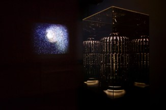 "Hush II, 2013, 24"" x24'x 80"" Acrylic mirrored, found birdcage, rice paper, pen and ink, with pedestal and Let me tell you a secret, 2009, dimensions variable, HD video 7 minutes, seven seconds looped. Photo credit: David Mielcarek"