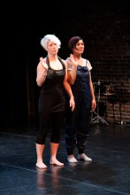 Megan Mazarick (left) and Christina Zani stand and look at the audience during their duo. Photo by Lindsay Brown.