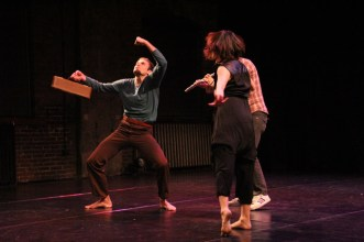 Beau Hancock gets silly with a flute case in a trio with dancer Eun Jung Choi and Billly Dufala (on flute). Photo by Lindsay Brown.