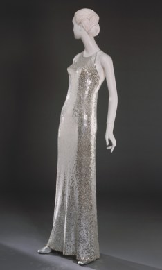 "Woman's ""Mermaid"" Evening Dress, designed by Norman Norell, Sold by Nan Duskin, Philadelphia American, c. 1960, Metallicized plastic sequins on silk knit, Center Back Length: 60 inches (152.4 cm) Circumference (Bust): 32 inches (81.3 cm), Waist: 28 inches (71.1 cm), bequest of Ellen Biedlingmaier, 1975"
