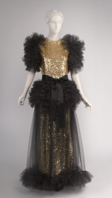 Gold and Black Evening Dress, designed by Hubert de Givenchy, French, Fall 1982, Plastic sequins on Lurex and cotton knit, nylon tulle, silk satin ribbon, Center Back Length: 57 inches (144.8 cm), Length (Sleeve): 14 inches (35.6 cm), Circumference (Bust): 38 inches (96.5 cm), Waist: 28 1/2 inches (72.4 cm), Width (Shoulders- across back): 15 inches (38.1 cm), Length (Collar to waist): 15 inches (38.1 cm), 125th Anniversary Acquisition, The Diane Wolf Collection, 1999