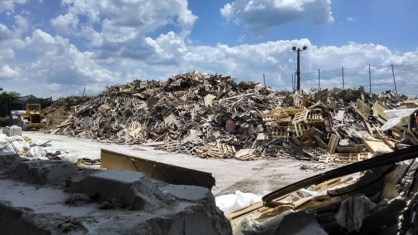A pile of wood at Revolution Recovery