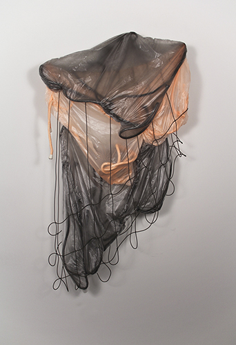 Untitled, 3' x 5' x 1', rope, rubber cord, hog rings, plastic, chalk, hardware. 2014.