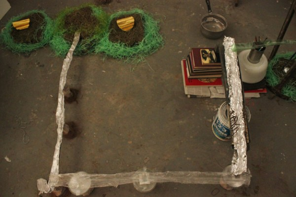 Aquaduct #1, October 2014, installation (turf, Easter grass, tin foil, ladder, water), dimensions variable.