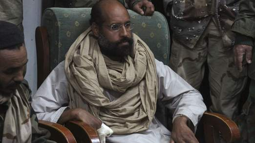 Saif al-Islam is seen after his capture, in the custody of revolutionary fighters in Obari, Libya