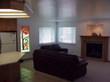 Kline family room addition showing stained glass window