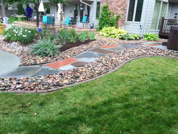 flagstone pathway with river rock