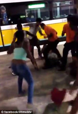 Once at the train station, the group spilled out onto the platform where they continued to attack Jones