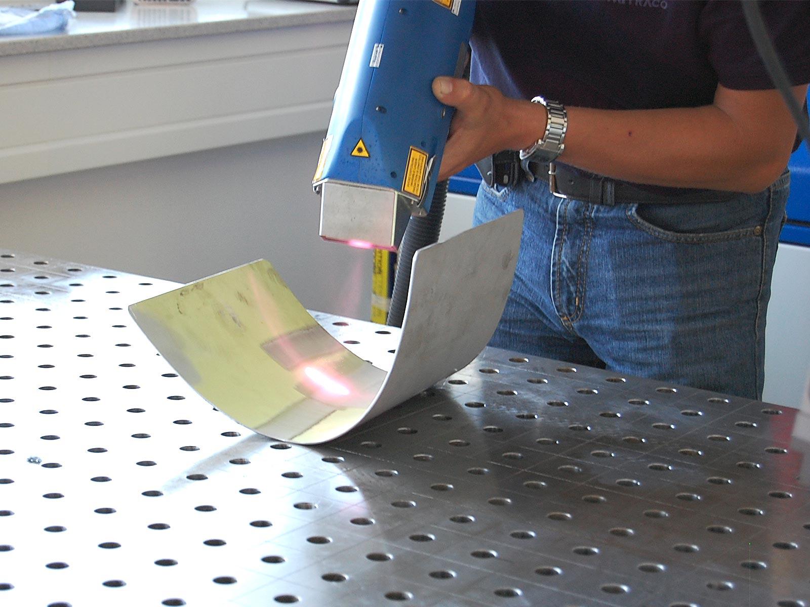 Laser Metal Stripping Laser Surface Cleaning  TLC Metal