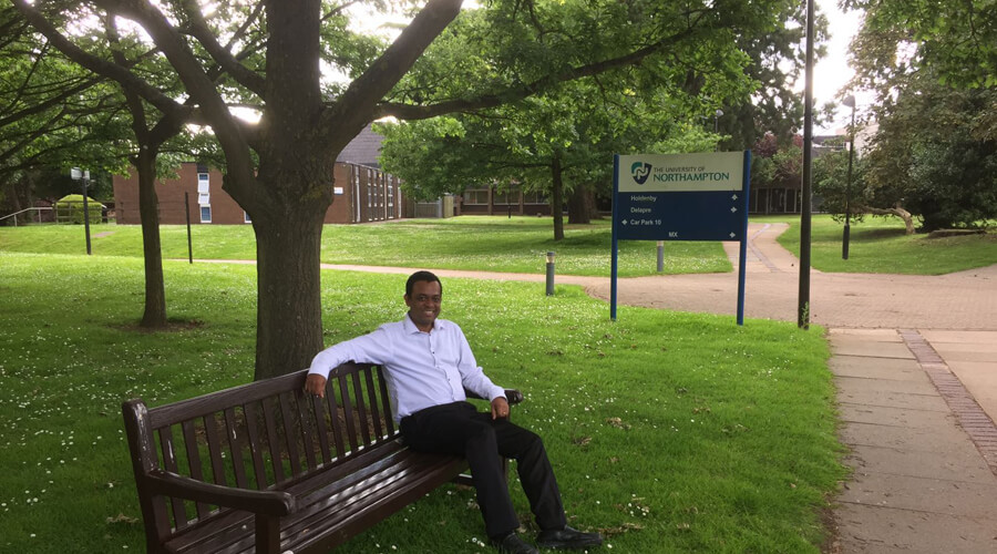 Pinaki resting at bench in University of Northampton