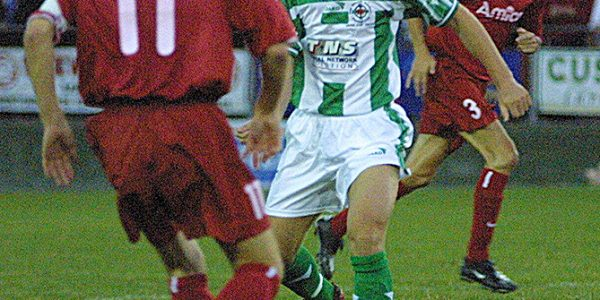 TNS V Amica Wronki (Poland) UEFA Cup at Latham Park, Newtown.    pic is David Bridgewater and Tomasz Djokvic.