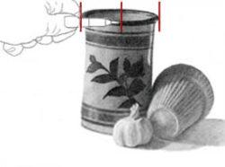 Measuring garlic bulb against vase. C. Rosinski