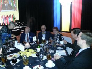 Bob Huddelston and Chloe at Table #1 with Past International President s during Golden Gavel Dinner.