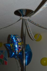 We used the pole in the middle of the room as the main focal point to string all of the streamers and balloons from :).