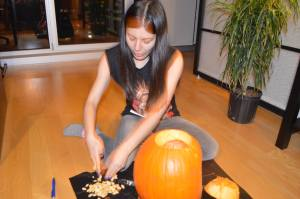 Gutting the pumpkin.