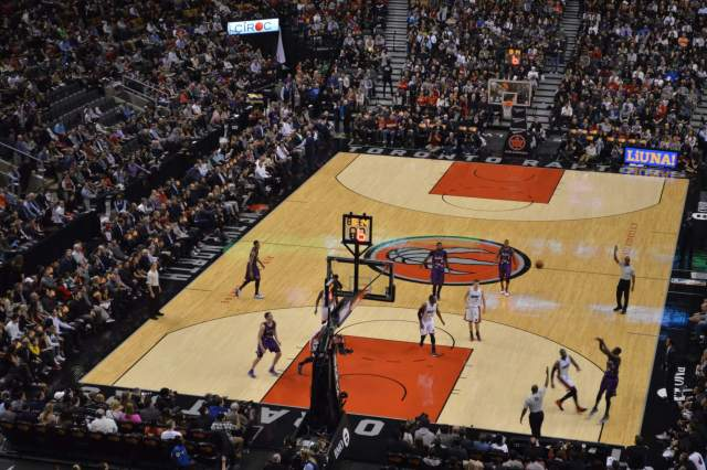 Action shot of Terrence Ross shooting a three point shot.