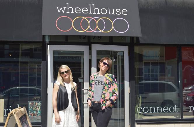 Owners of Wheelhouse Heather and Nadine standing outside of their spin studio.