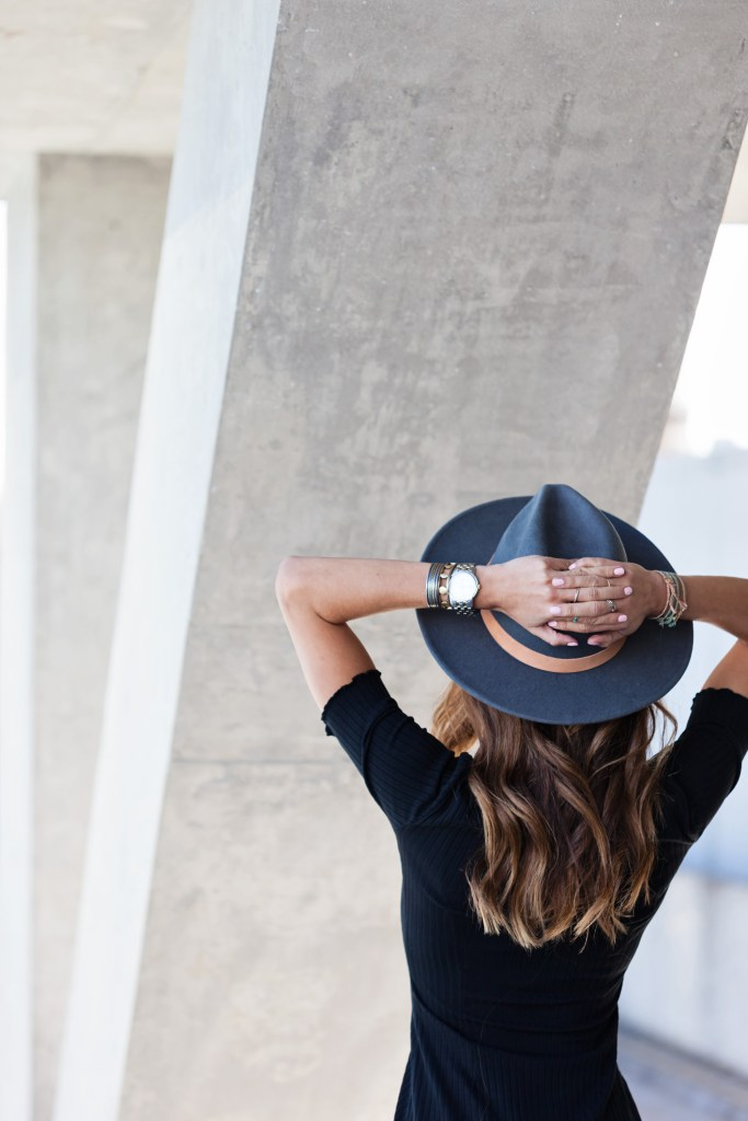 Blogger Kiara of TobruckAve wearing Lack of Color hat