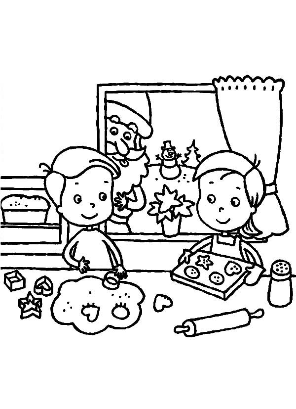 Two Kids Are Baking Cookies For Christmas Celebration
