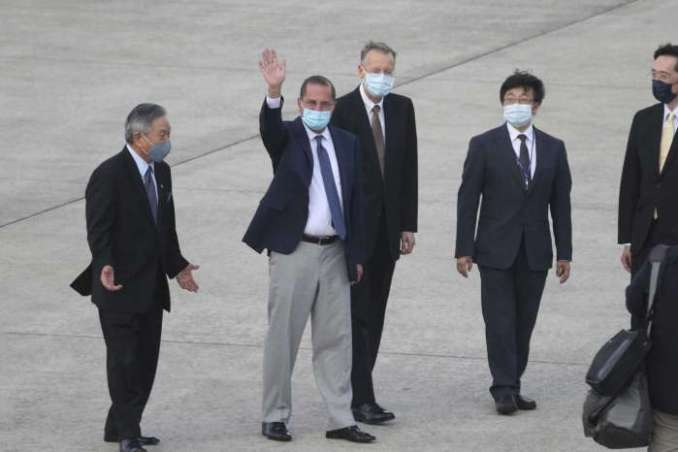 U.S. Health and Human Services Secretary Alex Azar, second left, waves to media as he arrives at Taipei Songshan Airport in Taipei, Taiwan, Sunday, Aug. 9, 2020. Azar arrived in Taiwan on Sunday in the highest-level visit by an American Cabinet official since the break in formal diplomatic relations between Washington and Taipei in 1979.Chiang Ying-ying/AP