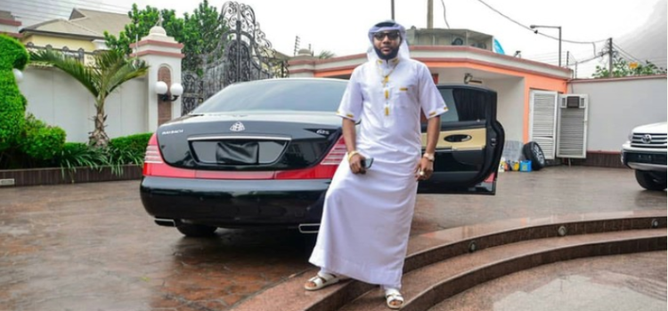 E money poses besides his brand new Maybach 62