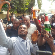 Policemen pop champagne to celebrate the arrest of top Boko Haram Commander(pics)